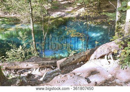 Natural Blue Coloured Wellspring Lake In Cheile Nerei, Ochiul Bei, Caransebes, Romania