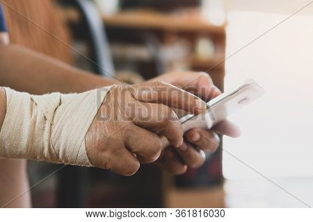Trigger Finger Or Finger Lock Disease, Office Syndrome Technology Concept. Businessman Trying Use Sm
