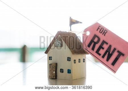 Miniature Home For Rent Mortgage Of Fee Concept: Diy Pink Model Driftwood With Tag Paper