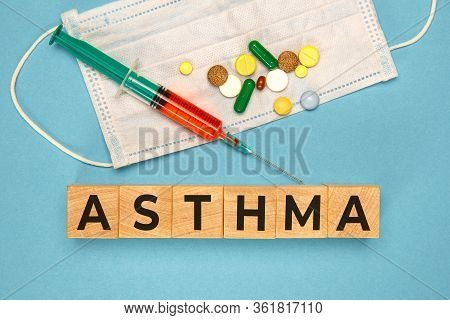 Asthma Word Made With Wood Cubes. Asthma Word As Medical Concept