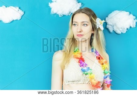 Hawaiian Woman Close Up On The Blue Background With Clouds