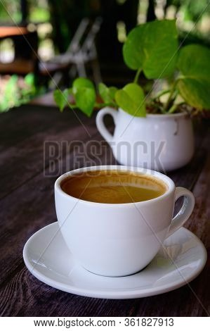 Hot Coffee Americano On The Old Wooden Table