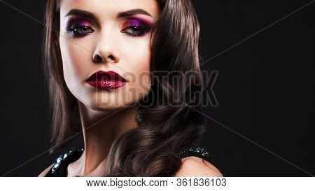 Gorgeous Young Brunette In A Chic Evening Look. Scarlet Lips And Eye Shadow, Wave Hair Styling