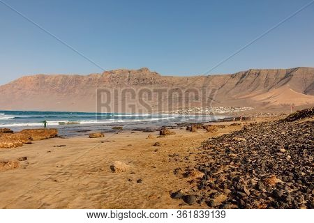 Famara Beach, Scenic Landscape With Ocean And Mountains In Lanzarote, Canary Islands