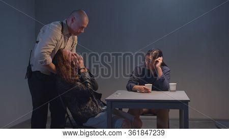 Good And Bad Cop. Police Officer Strangling A Criminal