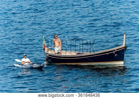Gulf Of La Spezia, Liguria, Italy - July 21, 2019: Two Men, One In A Kayak And One In A Small Wooden