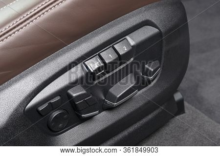 Power Seat Control Buttons Of A Luxury Passenger Car. Red Leather Interior Of The Luxury Modern Car.