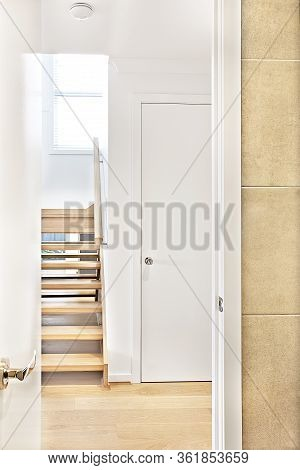 House Interior Door Entrance With An Open Door To Wooden Hallway Through The Stairs With Steps To Th