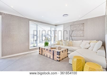 Sunlight Illuminated Living Room Interior With Sofa And Pillows With Windows, The Wooden Box With Me