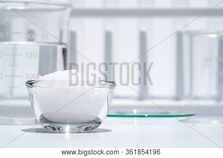 Close Up White Flake Chemical On Laboratory Table. Cetyl Esters Wax, Chemical Used In Otc Products A