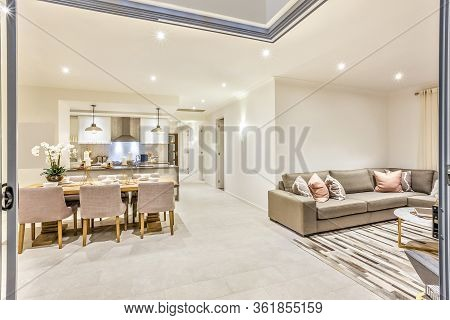 Modern House With A Door Entrance To The Living Room And Dining Kitchen Including Table Set Up Besid