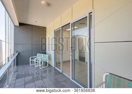 A Balcony With Contemporary Glass Rails And A Glass Sliding Door Looks Stylish With Simple Yet Smart
