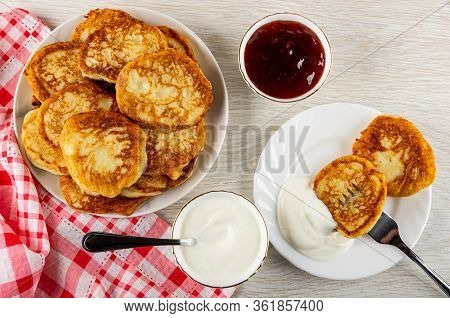 Checkered Napkin, Plate With Pancakes, Bowl With Strawberry Jam, Teaspoon In Bowl With Sour Cream, F
