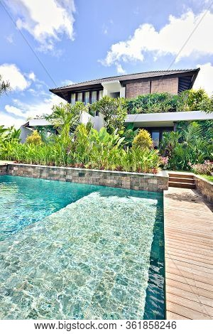 Modern Swimming Pool With Ornamental Plants At A Modern Hotel Garden With Clear Water Breathing With