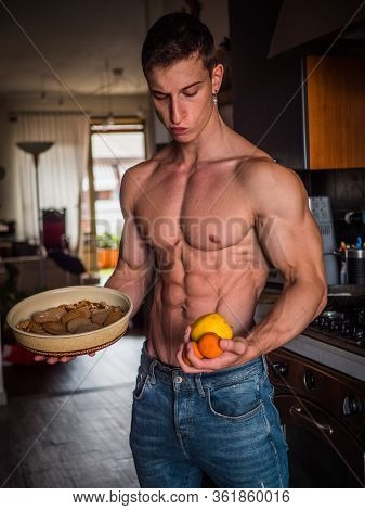 Young Man Deciding Between Healthy Fruit And Unhealthy Cookies