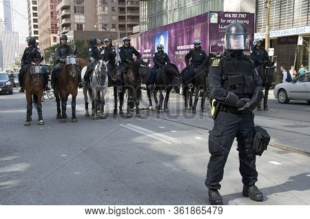 Toronto, Ontario, Canada - 06/25/2010 : Polices Horses With Visors In Downtown Toronto For The G20 S