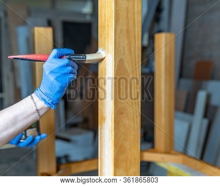 Varnishing Wooden Furniture With Brushes And Varnish In The Joinery