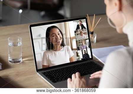 Asian Woman And Diverse Colleagues Taking Part In Group Videocall
