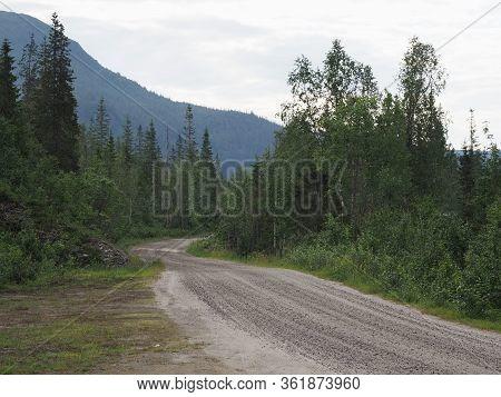 Gravel Road In Forest Landscapes Near European Svartisen Glacier In Nordland County In Norway, Cloud