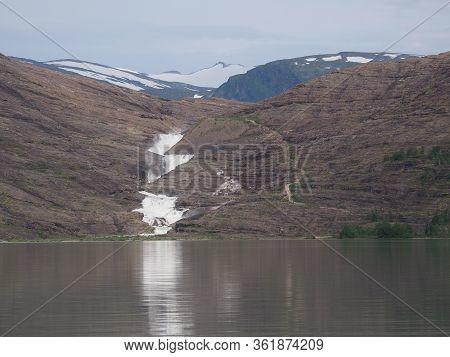 Natural Svartisvatnet Lake And Waterfall On Landscapes Near European Svartisen Glacier In Nordland C