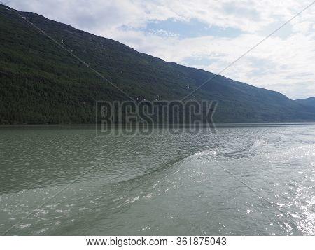 Mountainside Slope And Svartisvatnet Lake Landscapes Near European Svartisen Glacier In Nordland Cou