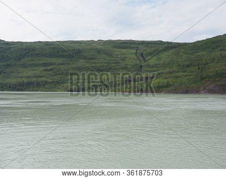 Mountain Slope And Svartisvatnet Lake Landscapes Near European Svartisen Glacier In Nordland County