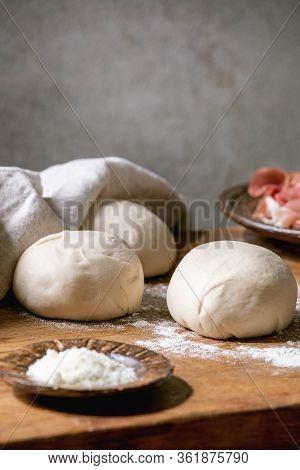 Dough For Italian Pizza Napolitana Cooking. Three Balls Of Fresh Homemade Wheat Dough, Prosciutto An