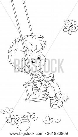 Cheerful Small Boy Swinging On A Summer Playground In A Park, Black And White Outlined Vector Cartoo