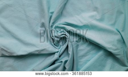 Wrinkled Soft Sheet Canvas Background. Light Blue And White Fabric Texture. Crumpled Bedding Linen C