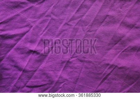 Creased Fabric Texture, Colorful Purple Colour Cloth Background. Wrinkled Worn Violet Color Shirt Fr