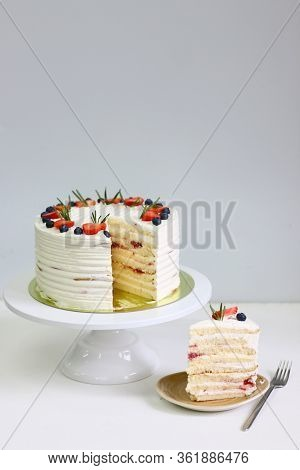 Crepe Cake With Strawberry Blueberry And Rosemary On Light Background. Crepes Cake With Cottage Chee