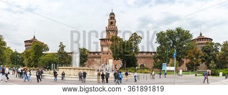Milan, Italy, 29 September, 2015 : Numerous Tourists And Residents Walk Along Castle Square Fountain