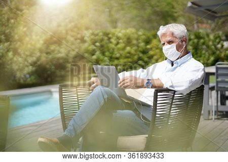 Man working on laptop from home during COVID19 pandemic