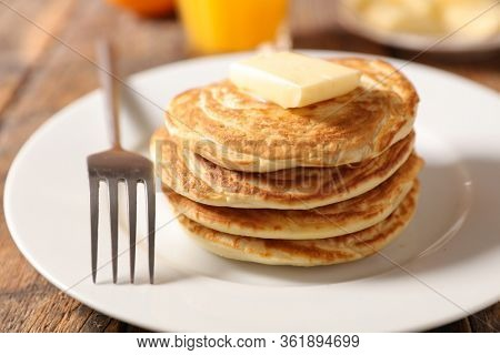 stack of pancake and butter