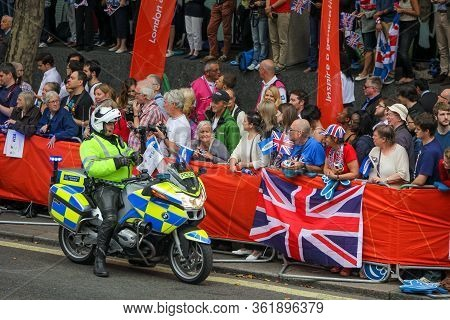 London, England - September 10 2012: Crowds Line The Streets Of London, To Celebrate The Achievement