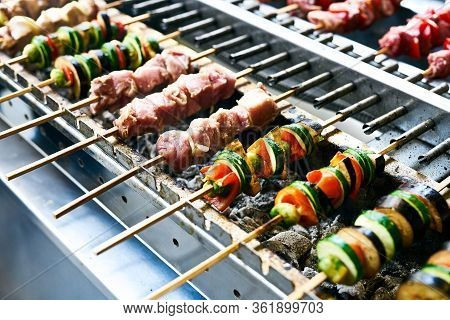 Meat And Vegetable Kebabs On Skewers Over Coals On Barbecue. Bbq Grilled Shish Meat On Skewers. Gril