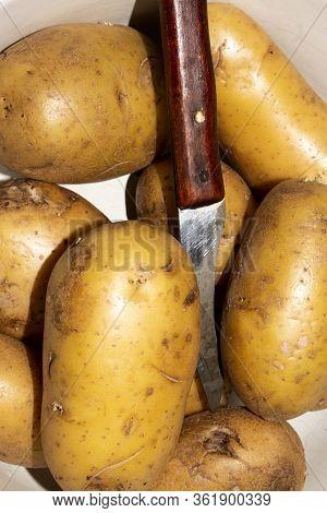 Fresh Unpeeled Potatoes.background Of Potatoes.cleaning Raw Potatoes.