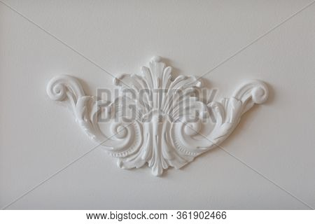Expensive Interior. Stucco Elements On Light Luxury Wall. White Patterned. Mouldings Element From Gy