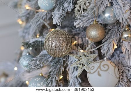 Gold Christmas Background Of De-focused Lights With Decorated Tree. Decorated Christmas Tree With Go