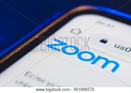 Logo Zoom App On The Screen Smartphone Closeup. Zoom Video Communications Is A Company That Provides
