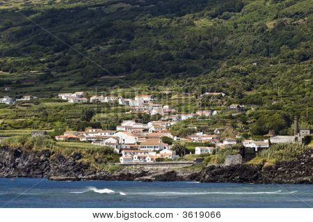 View from the sea of the small village of Ribeira do Meio in Pico island Azores Portugal poster