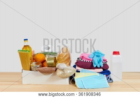 Quarantine Donation Box. Food, Clothing And Personal Protective Equipment. Food Delivery Concept.