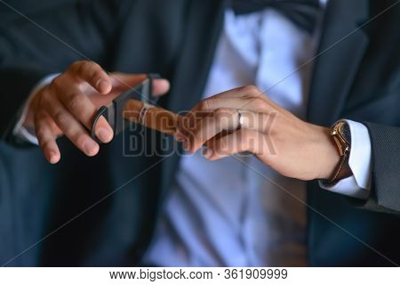 Cigar Pruning. Cigar On Hands Close-up, Dressing, Mans Style, Stylish Man. Elegant Young Handsome Ma