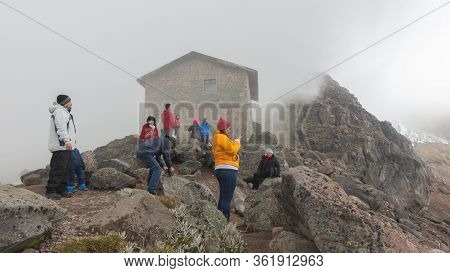 Cayambe, Pichincha / Ecuador - February 24 2020: Group Of Tourists Looking At The Landscape Of The C