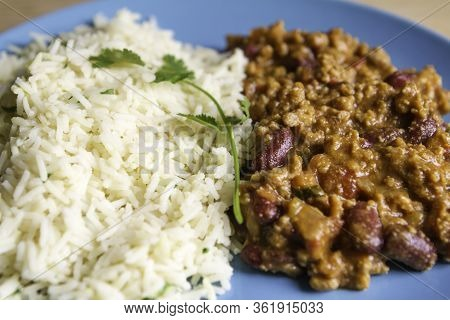 Tex Mex beef chili with tomatoes and red beans with rice and fresh coriander.