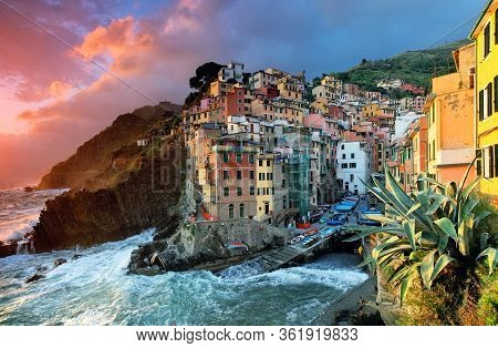 Riomaggiore of Cinque Terre, Italy - Traditional fishing village in La Spezia, situate in coastline of Liguria of Italy. Riomaggiore is one of the five Cinque Terre travel attractions.