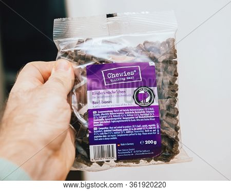 Paris, France - Feb 8, 2020: Man Hand Holding Package Of Fresh Chewies Training Maxi Dry Dog Food Wi