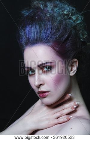 Vintage style portrait of young beautiful woman with fancy hairdo