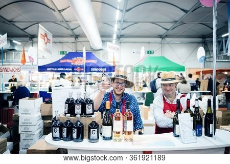 Strasbourg, France - Feb 16, 2020: Happy Winemakers With Wine At The Vignerons Independant English: