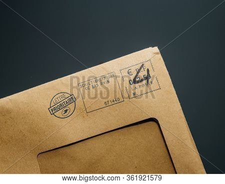 Paris, France - Feb, 25, 2020: Male Hand Holding French Paper Envelope Lettre Prioritaire Priority F